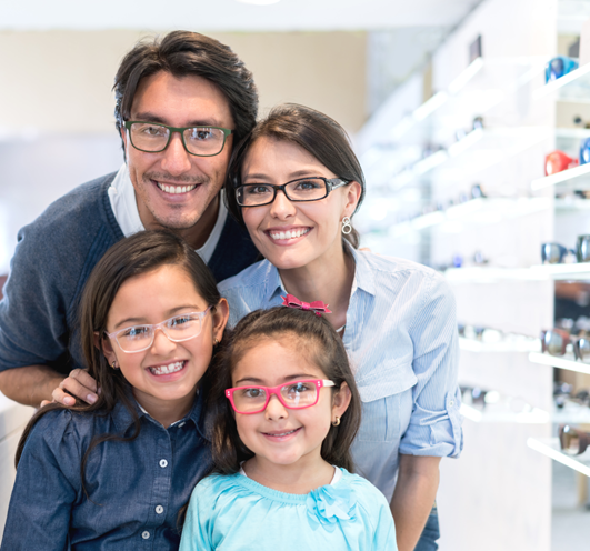 Happy family wearing glasses Professional Eye Care Center
